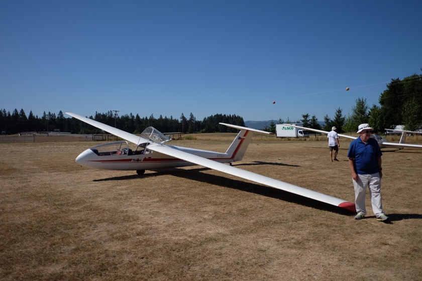 The two-seat glider we flew in. Don, the pilot, is off to the right. Note the single wheel for landing.