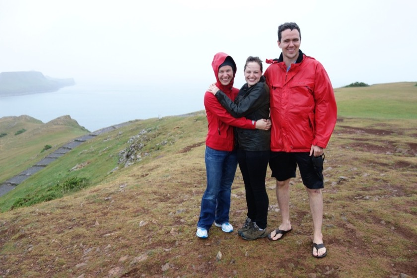 Rachael, Sarah, and Dan soaking up the rain in Wales.